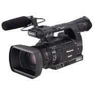 A handheld video camera with shotgun mic