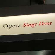 A sign for Opera Stage Door