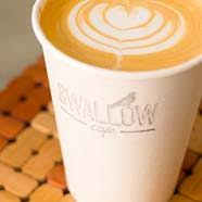 A heart pattern latte in a Swallow Cafe to go cup