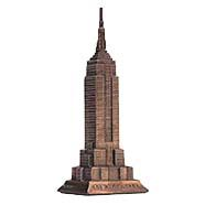 A brass figurine of the Empire State Builiding